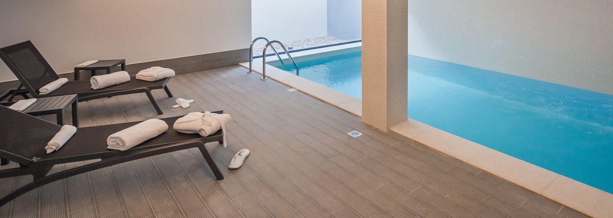 Leisure and Wellness - In the indoor pool, guests have a private space for relaxation and well-being at their disposal. Here too, the presence of the essences, combined with the indirect natural illumination provided by a small courtyard, invokes the senses, allowing a unique experience.